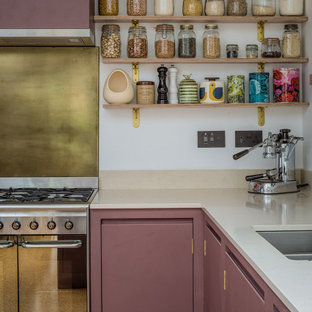 Inspiration for a small contemporary u-shaped eat-in kitchen in West Midlands with a drop-in sink, flat-panel cabinets, purple cabinets, quartz benchtops, black appliances and cork floors.