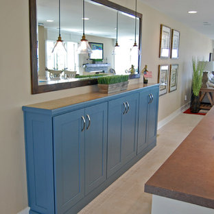 Inspiration for a large beach style u-shaped eat-in kitchen in Baltimore with shaker cabinets, with island, an undermount sink, stainless steel appliances, ceramic floors, blue cabinets and granite benchtops.