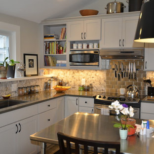 Design ideas for a small traditional l-shaped eat-in kitchen in Boston with an undermount sink, shaker cabinets, white cabinets, zinc benchtops, grey splashback, subway tile splashback and stainless steel appliances.