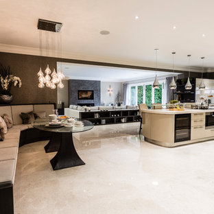 Design ideas for a contemporary open plan kitchen in Surrey with flat-panel cabinets, beige cabinets and an island.