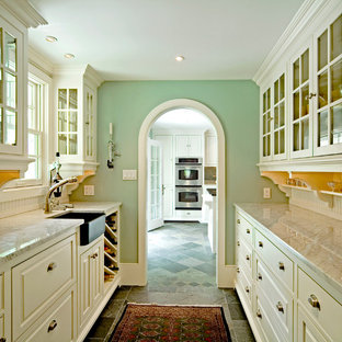 Kitchen - traditional kitchen idea in Philadelphia with a farmhouse sink and marble countertops