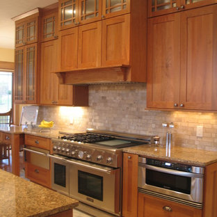 Mid-sized arts and crafts galley eat-in kitchen in Indianapolis with an undermount sink, recessed-panel cabinets, light wood cabinets, granite benchtops, black splashback, stone tile splashback, stainless steel appliances, slate floors and with island.