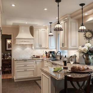 This is an example of a mid-sized traditional u-shaped eat-in kitchen in Montreal with a double-bowl sink, beaded inset cabinets, white cabinets, granite benchtops, beige splashback, stone tile splashback, panelled appliances, slate floors, a peninsula and grey floor.