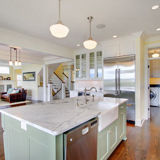 Traditional kitchen designs - Inspiration for a timeless kitchen remodel in Seattle with glass-front cabinets, stainless steel appliances, a farmhouse sink and green cabinets