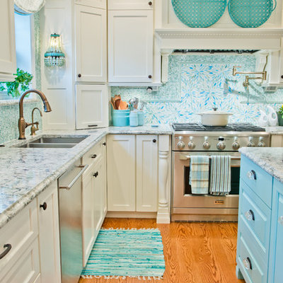 Example of a transitional medium tone wood floor kitchen design in St Louis with white cabinets, marble countertops, blue backsplash, stainless steel appliances, an island, an undermount sink, shaker cabinets and mosaic tile backsplash