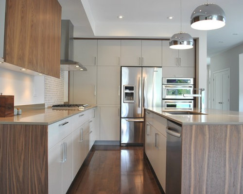Modern Kitchen Idea In Ottawa With Stainless Steel Appliances, Quartz  Countertops, Flat Panel