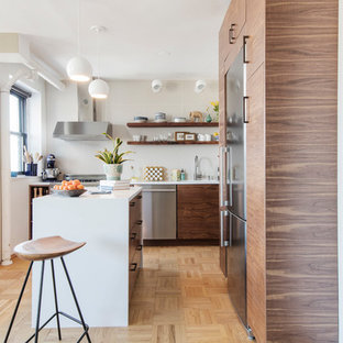 Contemporary Kitchen Designs   Example Of A Trendy L Shaped Light Wood  Floor And Beige
