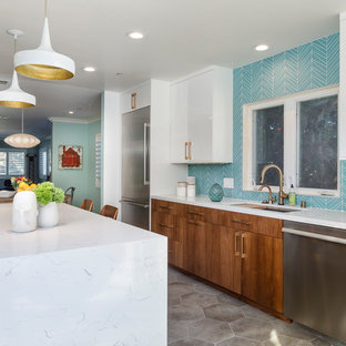 Large midcentury modern enclosed kitchen photos - Inspiration for a large 1950s u-shaped cement tile floor and gray floor enclosed kitchen remodel in Los Angeles with an undermount sink, flat-panel cabinets, medium tone wood cabinets, quartzite countertops, blue backsplash, glass tile backsplash, stainless steel appliances and an island