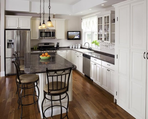 Traditional L Shaped Kitchen Idea In Boston With Raised Panel Cabinets And  White Cabinets