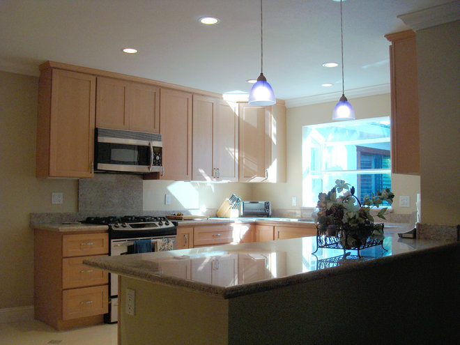 Traditional Kitchen by Comwest Construction