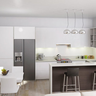 Small modern eat-in kitchen designs - Inspiration for a small modern l-shaped light wood floor eat-in kitchen remodel in Other with an undermount sink, flat-panel cabinets, white cabinets, granite countertops, white backsplash, cement tile backsplash, stainless steel appliances and a peninsula
