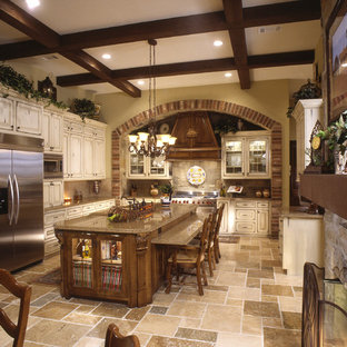 Photo of a country galley eat-in kitchen in Houston with a farmhouse sink, raised-panel cabinets, distressed cabinets, granite benchtops, brown splashback, stone tile splashback, stainless steel appliances, ceramic floors and with island.