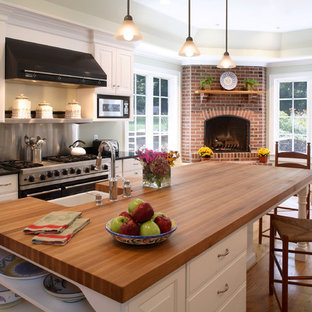 Kitchen - traditional kitchen idea in Baltimore with a farmhouse sink and wood countertops