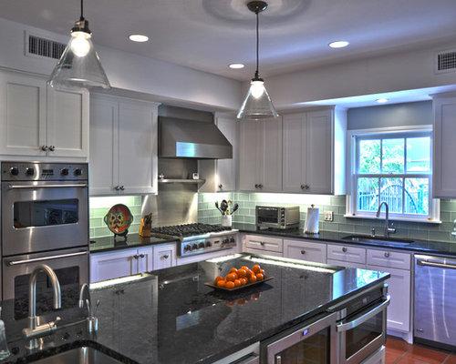 kitchen with glass tile backsplash and terra cotta floors