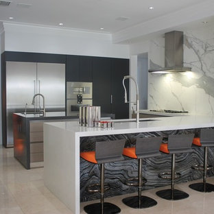Mid-sized contemporary kitchen inspiration - Example of a mid-sized trendy l-shaped marble floor and beige floor kitchen design in Miami with white cabinets, an integrated sink, marble countertops, gray backsplash, ceramic backsplash and two islands