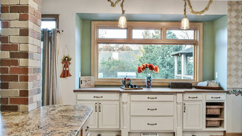 Kitchen Alcove with Painted Glazed Raised Paneled Doors and Wood Countertop