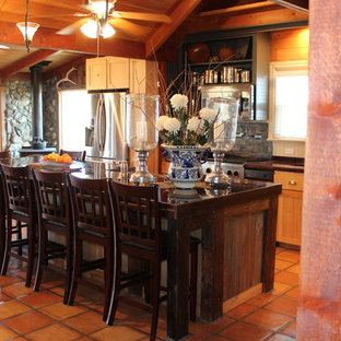 Design ideas for a large country galley eat-in kitchen in Boise with a farmhouse sink, open cabinets, light wood cabinets, wood benchtops, beige splashback, stainless steel appliances, terra-cotta floors, with island, slate splashback and orange floor.