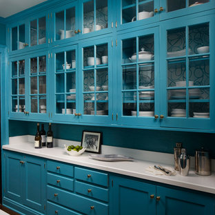 Photo of a medium sized traditional galley kitchen pantry in Chicago with glass-front cabinets, blue cabinets, quartz worktops, white splashback and dark hardwood flooring.