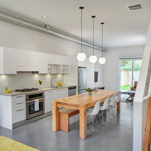 Contemporary kitchen designs - Trendy single-wall kitchen photo in Chicago with flat-panel cabinets and white cabinets