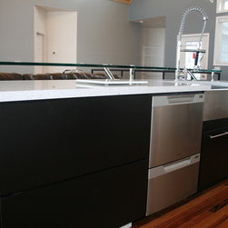 """Kitchen & Bath Photo Gallery - Diamond Distinction cabinetry in Trystan Black with Cambria Natural Quartz in Whitney with a 3/4"""" glass bar top."""