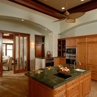 Large tropical kitchen pictures - Kitchen - large tropical u-shaped travertine floor and beige floor kitchen idea in Hawaii with medium tone wood cabinets, granite countertops, stainless steel appliances, an island, an undermount sink, shaker cabinets, green backsplash and stone slab backsplash