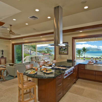 Large island style u-shaped ceramic tile and beige floor open concept kitchen photo in Hawaii with a farmhouse sink, flat-panel cabinets, medium tone wood cabinets, granite countertops, stainless steel appliances and a peninsula