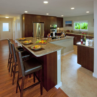 Large tropical kitchen ideas - Large island style u-shaped ceramic floor and beige floor kitchen photo in Hawaii with an undermount sink, flat-panel cabinets, medium tone wood cabinets, granite countertops, stainless steel appliances and an island