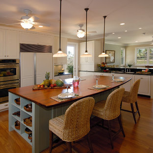 Large transitional kitchen ideas - Kitchen - large transitional u-shaped medium tone wood floor and brown floor kitchen idea in Hawaii with an undermount sink, white cabinets, granite countertops, green backsplash, subway tile backsplash, an island and paneled appliances