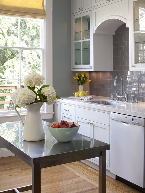 Traditional Kitchen Idea In San Francisco With Glass Front Cabinets And  Stainless Steel Appliances