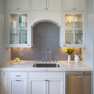 Traditional kitchen remodeling - Elegant kitchen photo in San Francisco with glass-front cabinets, subway tile backsplash and stainless steel appliances