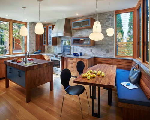 mid sized trendy light wood floor eat in kitchen photo in philadelphia with an