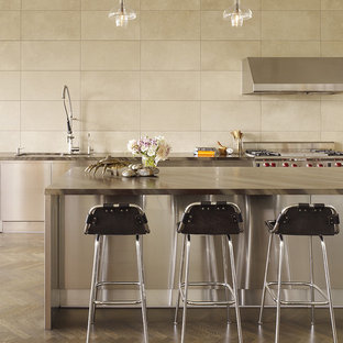 Kitchen - contemporary kitchen idea in San Francisco with stainless steel appliances and travertine backsplash