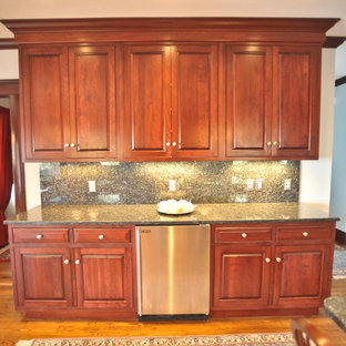 Large traditional l-shaped eat-in kitchen in Boston with an undermount sink, raised-panel cabinets, dark wood cabinets, granite benchtops, stainless steel appliances, medium hardwood floors and with island.