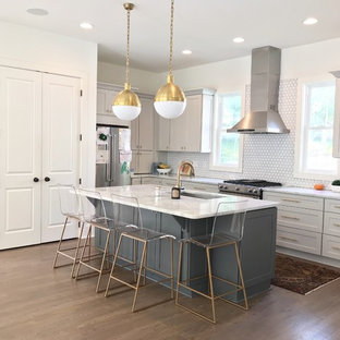 Photo of a mid-sized transitional l-shaped kitchen pantry in Atlanta with a single-bowl sink, shaker cabinets, grey cabinets, marble benchtops, white splashback, porcelain splashback, stainless steel appliances, medium hardwood floors, with island, grey floor and green benchtop.