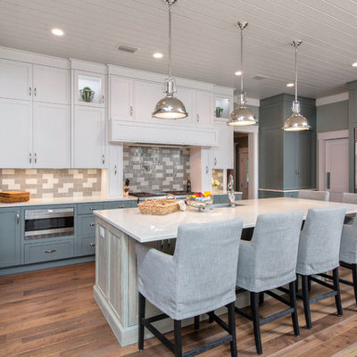Example of a large transitional u-shaped kitchen design in Jacksonville with shaker cabinets, multicolored backsplash, subway tile backsplash, stainless steel appliances and an island