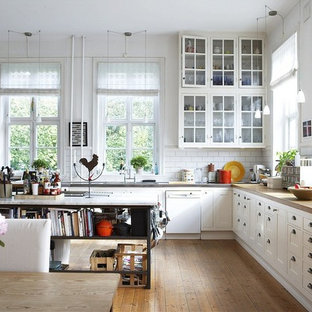 Large traditional kitchen designs - Inspiration for a large timeless medium tone wood floor kitchen remodel in Other with shaker cabinets, wood countertops, white backsplash, white appliances, white cabinets, an island and subway tile backsplash