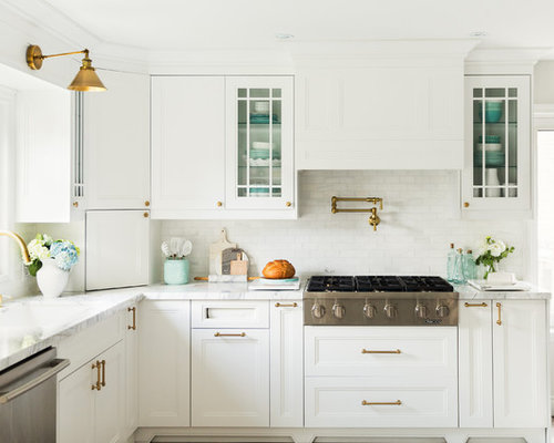 Example Of A Country Kitchen Design In Toronto With An Undermount Sink Beaded Inset Cabinets