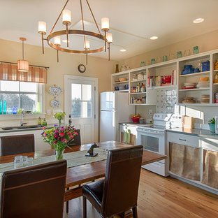 Small farmhouse eat-in kitchen ideas - Small farmhouse l-shaped light wood floor eat-in kitchen photo in Richmond with an undermount sink, open cabinets, white cabinets, quartzite countertops, white backsplash, glass tile backsplash, white appliances and no island