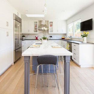 Mid-sized transitional kitchen remodeling - Mid-sized transitional u-shaped light wood floor and beige floor kitchen photo in San Francisco with shaker cabinets, white cabinets, white backsplash, an island, a single-bowl sink, marble countertops, marble backsplash and stainless steel appliances