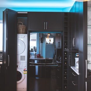 Inspiration for a mid-sized modern u-shaped eat-in kitchen in Other with a single-bowl sink, shaker cabinets, grey cabinets, quartz benchtops, blue splashback, window splashback, black appliances, vinyl floors, a peninsula, brown floor and white benchtop.