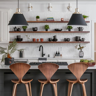 Mid-sized modern eat-in kitchen designs - Example of a mid-sized minimalist l-shaped dark wood floor and brown floor eat-in kitchen design in Atlanta with open cabinets, dark wood cabinets, quartzite countertops, white backsplash, an island, white countertops, a drop-in sink, ceramic backsplash and stainless steel appliances