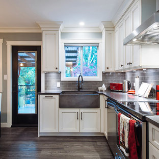 Design ideas for a large country l-shaped eat-in kitchen in Vancouver with a farmhouse sink, recessed-panel cabinets, distressed cabinets, quartz benchtops, grey splashback, ceramic splashback, stainless steel appliances, vinyl floors, with island and grey floor.