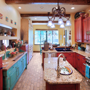Inspiration for a kitchen in Tampa with red cabinets, a drop-in sink, raised-panel cabinets and stainless steel appliances.