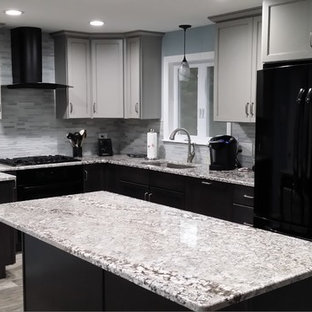 This is an example of a medium sized classic u-shaped open plan kitchen in Boston with a submerged sink, shaker cabinets, black cabinets, granite worktops, grey splashback, glass tiled splashback, stainless steel appliances, slate flooring, an island and grey floors.