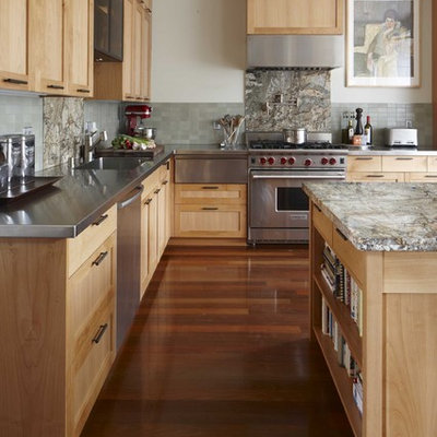 Transitional kitchen photo in San Francisco with stainless steel appliances, stainless steel countertops, shaker cabinets, light wood cabinets, green backsplash and an integrated sink