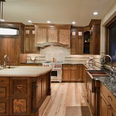 Rustic Kitchen by Aneka Interiors Inc.