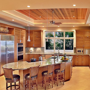 This is an example of a large contemporary u-shaped kitchen in Hawaii with an undermount sink, louvered cabinets, medium wood cabinets, granite benchtops, grey splashback, stone slab splashback, stainless steel appliances and with island.