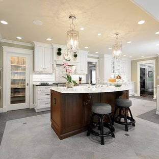 Large traditional kitchen photos - Inspiration for a large timeless u-shaped gray floor kitchen remodel in Louisville with white cabinets, recessed-panel cabinets, white backsplash, paneled appliances, an undermount sink, quartz countertops, an island and white countertops