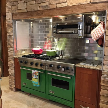 Stainless Steel Backsplash with Green Viking Range