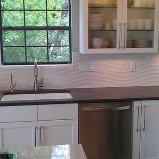 Photo of a contemporary l-shaped kitchen/diner in Austin with a submerged sink, recessed-panel cabinets, white cabinets, quartz worktops, white splashback, ceramic splashback and stainless steel appliances.